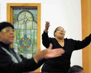 Youngstown resident Lillian Howell of Elizabeth Missionary Baptist Church sings praises during a united Thanksgiving worship service with New Birth-Kimmelbrook Baptist Church, Metropolitan Baptist Church, Phillips Chapel CME Church and Holy Trinity Church. The Wednesday service was at Elizabeth Missionary Baptist Church.