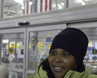 William D. Lewis|The Vindicator A large crowd qued up outside the Boardman Best Buy at 5am Friday to get Black Friday bargins. NicoleNixon of Youngstown was first in the line.