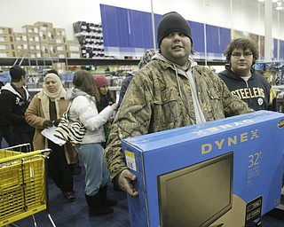 William D. Lewis|The Vindicator A large crowd qued up outside the Boardman Best Buy at 5am Friday to get Black Friday bargins. Among the shopper to find just what they were looking for were Trevor Motsko, left, and Josh Cutlip of Struthers.