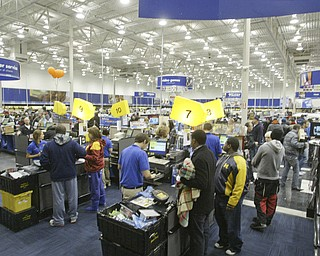 William D. Lewis|The Vindicator A large crowd qued up outside the Boardman Best Buy at 5am Friday to get Black Friday bargins. Customers check out with bargins..