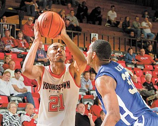 YSU's Damian Eargle lines up a shot while being guarded by Buffalo's Jawaan Alston (32) during a game at YSU's Beeghley Center on November 16, 2010.