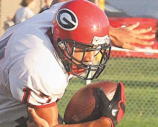 Eric Ahmer makes a one handed tackle of Landon Smith Friday night in Struthers.