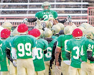 Akise Teague is hoisted onto the shoulders of his teamate after being named Mr. Ohio during Ursuline's football practice at Stambaugh Stadium on Wedesday December 1, 2010.