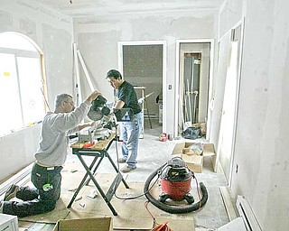 Construction workers, who did not wish to be identified, added trim to the door frames in the new addition. Mission of Love paid for the materials and labor.
