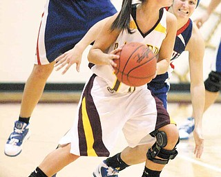 BASKETBALL - (10) Kenzie Pfeiffer of South Range looks for help as (10) Colleen Kenneham keeps a close eye on her during their game Thursday night. - Special to The Vindicator/Nick Mays