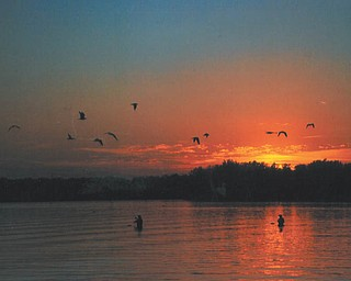 These fisherman were likely unaware that Lana VanAuker of Canfield captured them in this shot of a fall sunset in Lake Milton.