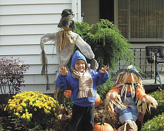 Jeremy Lodwick of Youngstown is just hanging out with the scarecrows at his Great-grandma Vargo's house in Hubbard.