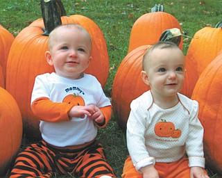 """Jimmy, left, and Shayleigh Leslie, 11-month-old twins of Jimmy and Melissa Leslie of Austintown, enjoy going """"pumpkin patching"""" at Whitehouse Fruit Farm. The twins were born in November of 2009. Photo sent in by Jimmy and Melissa Leslie."""