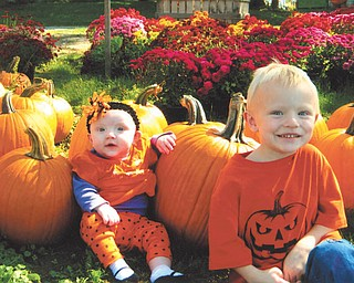 Luke Rowe, 4, right, and his sister Trista, 6 months, picked out their pumpkins at Detwiler Farm in October. They are the children of Mark and Tiffany Rowe of Boardman, who also sent in this photo.