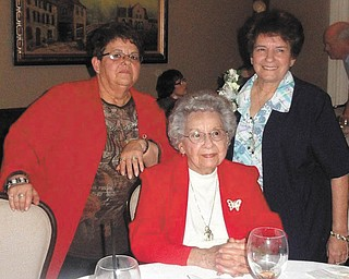 Catholic Charities retirement: From left to right are Flo Prokop, Virginia Santone and Maria Carson. Carson, who was honored during a recent party at Alberini's restaurant, retired as financial director after 47 years of employment at the Catholic Charities Regional Agency. In attendance for the celebration were co-workers, family, board members and friends. Santone is Carson's mother, and Prokop, who retired in August from CCRA, is her sister. Carson began as a secretary at the agency. While working as office manager, she completed her bachelor's degree in accounting from Youngstown State University. She had been financial director for the past 14 years.