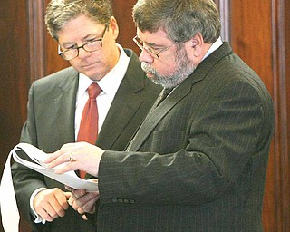 Before testifying at a court hearing on unsealing documents in the Oakhill Renaissance Place criminal case, Atty. John F. McCaffrey, left, talks with expert witness Hugh J. Martin of Ohio University.