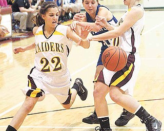 (22) Lexi Naples and (40) Elli Stoffer of South Range try to keep (10) Emily Rollo from the ball during their game Monday night.