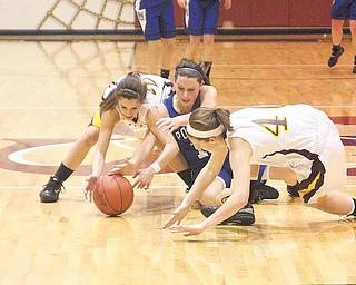 (22) Lexi Naples and (40) Elli Stoffer of South Range try to keep (12) Alyssa Shields from the ball during their game Monday night.