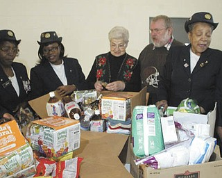 William D. Lewis | The Vindicator/Giving a helping hand to vets: Auxiliary members of American Legion Post 504, 2225 Glenwood Ave., Youngstown, recently gathered items to be donated to needy veterans in the area. On hand Dec. 2 at the post home when the donation was made were, from left, auxiliary members Yolanda Charles, Rose Jordan and Shirley Griffin; Faye Humbertson, American Legion Auxiliary representative at the Youngstown Veterans Affairs Outpatient Clinic on Belmont Avenue in Youngstown; Robie Rhoads, a veteran staying at the Meridian Services home for veterans in Youngstown; and auxiliary members Lillie Langford and Betty Dukes.