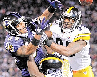 Pittsburgh Steelers cornerback Bryant McFadden (20) and safety Ryan Clark (25) break up a pass intended for Baltimore Ravens wide receiver T.J. Houshmandzadeh (84) during the second half of an NFL football game, Sunday, Dec. 5, 2010, in Baltimore. The Steelers won 13-10.