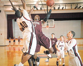 Boardman's Tre Robinson, #3, goes up with the ball against Campbell's # 40  during their game at Campbell on Tuesday night.