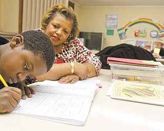 Second Grader, Kevin Myers, 8, works with volunteer, Wanda Smith, of Youngstown, on math work during an afterschool program at Christ Church Presbyterian Church on Wednesday evening.