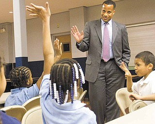 Mayor Jay Williams speaks with children about the importance of school and his job as mayor during an afterschool program at Christ Church Presbyterian Church.