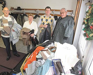Promoters of the Warm and Cuddly Drive at First Free Will Baptist Church in Austintown hold coats donated to the project. From left are: Harold Davis, deacon; Mary Hutchison, coordinator; Aaron Justice, youth minister; and Jack Hutchison, board member.