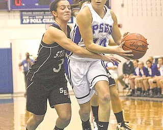 10) Emily Rollo of Poland drives to the hoop as (3) Adrianna Garchar plays tight defense during their game Thursday night.