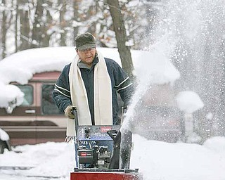 Jimmie Digiacobbe of state Route 5 in Cortland uses his snow blower to clear his property Thursday.  The Mahoning Valley has recorded a near-record level of snowfall this December and certainly will set a new monthly record over the next three weeks.