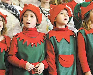 """Singing elves, from left, Alexia Stoy, Owen Banko, James Jones and Samantha Misik performed Thursday in a production called """"Holidays Around the World."""" This is the third year Lloyd Elementary School in Austintown has presented the production."""