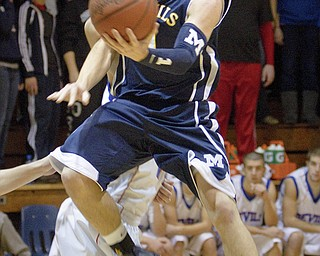 McDonald's Justin Rota (1) drives to the net during a game at Western Reserve High School on Friday evening.