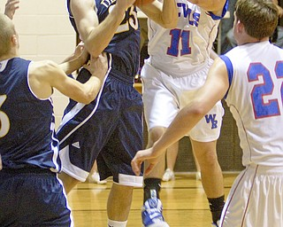 McDonald's Nick Rota (23) wrestles for control of the ball with Western Reserve's Thomas Marlowe (11) during a game at Western Reserve High School on Friday evening.