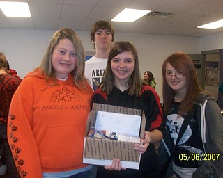 The freshmen at Struthers High School participated in The VindicatorÕs Operation Holiday Cheer project recently. The students put together 17 packages and wrote 180 letters to send to area soldiers. Among those involved in the project were, from left, Amanda Svenson, Crystal Karnes, Evan John and Caitlyn Schuller.