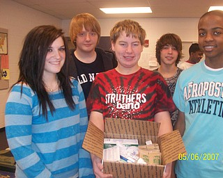 The freshmen at Struthers High School participated in The Vindicator's Operation Holiday Cheer project recently. The students put together 17 packages and wrote 180 letters to send to area soldiers. Among those involved in the project were, from left, Rachel Buser, Austin Freet, David Joliff, D.J. Kegarise and Isaiah Bush.