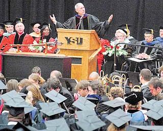 Eric D. Fingerhut, Chancellor of the Ohio Board of Regents, speaks to Youngstown State University graduates on many topics including the history and excellence of Ohio's educational system to finding employment in uncertain times. Fingerhut received an honorary degree, joining more than 700 students in Sunday's commencement in Beeghly Center.