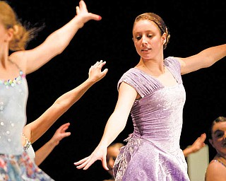 """Marie Stephenson, center, dances during a performance of """"Miracle on 34th Street"""" at South Range High School Sunday afternoon. The performance, which was organized, in part by Stephenson as her senior project, features dancers from Kathi's Dance and Gym Center and benefits Cystic Fibrosis research."""