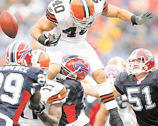 Cleveland Browns running back Peyton Hillis (40) fumbles the ball as he is hit by Buffalo Bills defender Jairus Byrd (31) during the first half of an NFL football game in Orchard Park, N.Y., Sunday, Dec. 12, 2010. Bills linebacker Paul Posluszny (51) assists on the play.