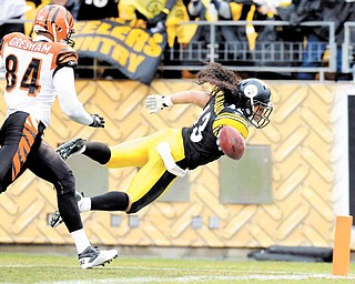 Pittsburgh Steelers safety Troy Polamalu (43) scores a touchdown on an interception as Cincinnati Bengals tight end Jermaine Gresham (84) defends during the second quarter of an NFL football game, Sunday, Dec. 12, 2010, in Pittsburgh.