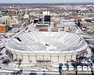 The collapsed Metrodome can be seen in Minneapolis Sunday, Dec. 12, 2010.   The inflatable roof of the Metrodome collapsed Sunday after a snowstorm that dumped 17 inches on Minneapolis. No one was hurt, but the roof failure sent the NFL scrambling to find a new venue for the Vikings' game against the New York Giants.
