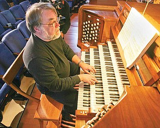 Richard Konzen plays. The professor of music at Grove City College and nationally renowned organist helped to show off the organ Monday.