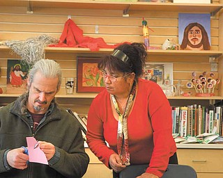 Steven Reese and Ida Morales of Youngstown participate in a free printmaking class at the D.D. and Velma Davis YMCA in Boardman. The facility is offering free art classes each day this week.