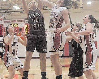 BASKETBALL - (40) Kayleigh Lipke of Boardman and (15) Abby Baker fight for the ball during their game Wednesday night in Canfield. (44) Sabrina Mangapora (23) Sarah Vrabel of Canfield and (21) Brooke Meenachan of Boardman are in on the play.