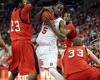 North Carolina State's C.J. Leslie (5) pulls down an offensive rebound surrounded by three Youngstown State players during first half of an NCAA college basketball game on Thursday, Dec. 16, 2010, at the RBC Center in Raleigh, N.C.  (AP Photo/TheNews & Observer, Michael McLoone)