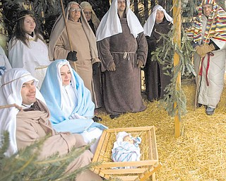Joseph and Sherrie Manners play the roles of Joseph and Mary during a live nativity scene held at St. Joseph and Immaculate Heart of Mary School in Austintown.