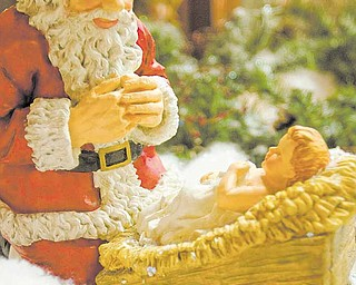 A kneeling Santa and Baby Jesus lay amidst Christmas Decorations at The Rescue Mission in Youngstown on Tuesday afternoon.