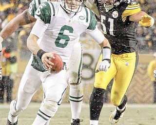New York Jets quarterback Mark Sanchez (6) scambles up the middle past Pittsburgh Steelers linebacker James Farrior (51) for 6-yards during the fourth quarter of an NFL football game in Pittsburgh, Sunday, Dec. 19, 2010. The Jets won 22-17.