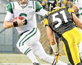 New York Jets quarterback Mark Sanchez, left, scrambles during the first quarter of an NFL football game against the Pittsburgh Steelers in Pittsburgh, Sunday, Dec. 19, 2010. In pursuit is Steelers linebacker James Farrior (51).