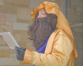 An actor portraying one of the wise men at a live nativity scene held at St. Joseph and Immaculate Heart of Mary School in Austintown.