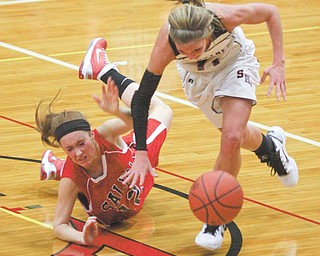 (11) Katelyn Ardale of Struthers and (12) Peyton Meals get tangled up going for the ball during their game Monday night in Struthers.