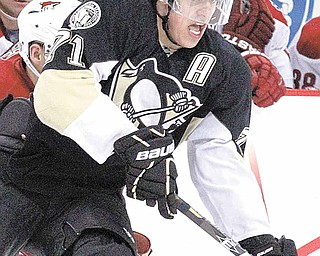 Pittsburgh Penguins' Evgeni Malkin (71), of Russia, skates past a Phoenix Coyote defender during the second period of an NHL hockey game in Pittsburgh on Monday, Dec. 20, 2010. The Penguins won 6-1. Malkin tied a career high with five points.