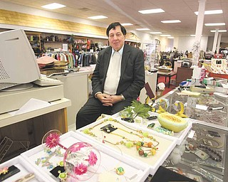 Gary Abrams, president and chief executive officer of Kolby's Clothing on East State Street, Salem, poses with some of the items available at his store. The longtime clothing store is closing, due in part to the declining economy, and leaving downtown with few shopping venues.