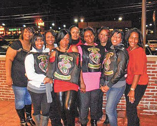 Dangerous Curvez ahead: The women's motorcycle club Dangerous Curvez Inc. made financial awards to three organizations at the annual Christmas Party on Dec. 11 at O'Charley's in Boardman. Zina Hill accepted a check for Dress For Success in the absence of its CEO, Felicia Davis; Patricia Rudolph represented My Best Tea Party Club; and Crystal Wells accepted for Listen Up Ladies.