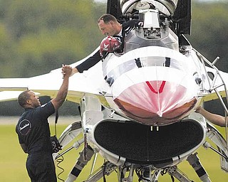 TEAMWORK. Crew Chief, Staff Sgt. Anthony Stewart, of New Orleans, LA, shakes hands with Thunderbird Slot Pilot, Maj. Sean Gustafson, of Kenora, Ontario, at the Youngstown Air Reserve Station in Vienna, OH on August 6, 2009. The Thunderbirds arrived at the base in preparation for a performance for the 2009 Youngstown Air Show, the first air show at the base in nearly a quarter century.