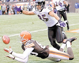 Cleveland Browns wide receiver Brian Robiskie, bottom, catches a 29-yard touchdown pass against Baltimore Ravens cornerback Chris Carr (25) in the first quarter of an NFL football game Sunday, Dec. 26, 2010, in Cleveland. The scoring pass was thrown by wide receiver Mohamed Massaquoi.